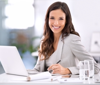 business woman looking at real estate agent website