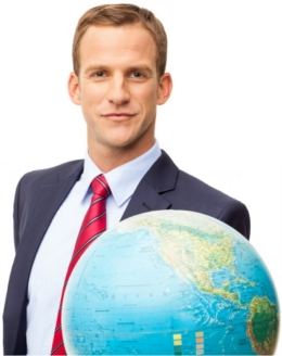 business person looking at globe